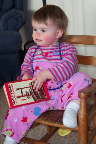 Abbye reading Mark Twain