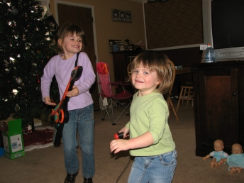 Abbye, Hannah jamming out with new guitar and microphone!